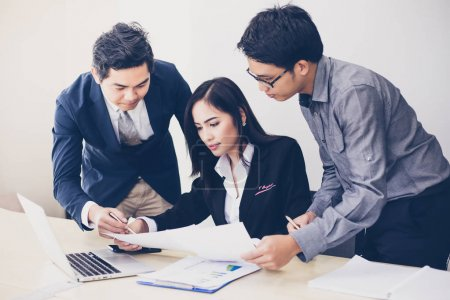 Asian businessmen and group using notebook for business partners