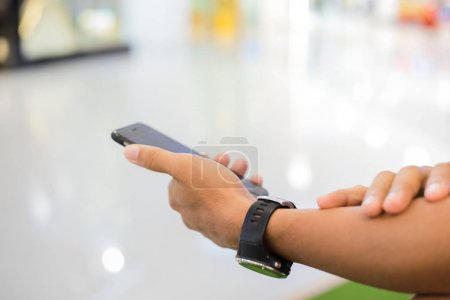 Photo for Man asian using phone for celling and texting on her mobile phone - Royalty Free Image