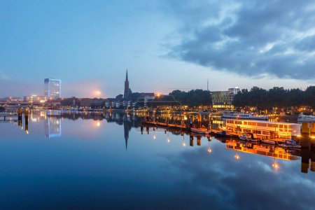 Reflection of Bremen Landmarks in river Weser