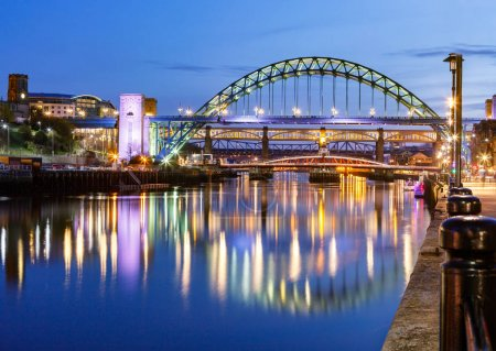 Seven bridges spanning over wide Tyne create together most characteristic view of Newcastle, United Kingdom.