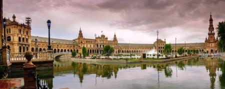 Water reflecting Renaissance building in Plaza de Espana in Seville, Andalusia, Spain.