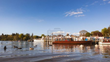 Boats and ferries ready to take tourist around the Windermere Lake, UK