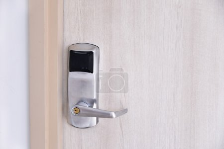 Entrance wood door with electronic keycard lock system
