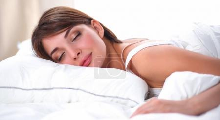 Photo for Beautiful girl sleeps in the bedroom, lying on bed, isolated - Royalty Free Image