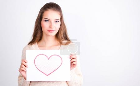 Portrait of young beautiful woman showing gift card. Valentines Day