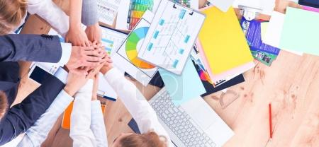Business team with hands together - teamwork concepts