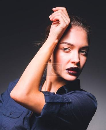 Portrait of beautiful young woman face. Isolated on black background