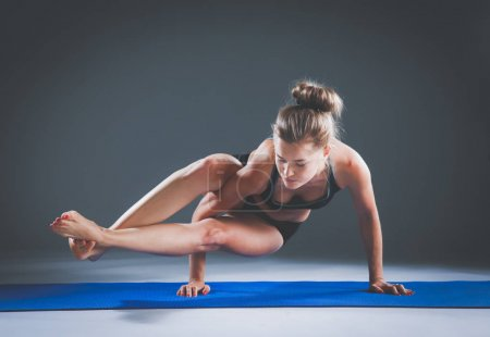 Portrait of sport girl doing yoga stretching exercise . yoga