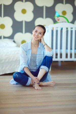 Young woman doing yoga at home in the lotus position. Young woman doing yoga.