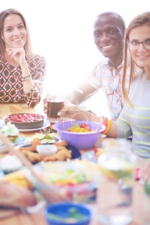 Photo for Top view of group of people having dinner together while sitting at wooden table. Food on the table. People eat fast food - Royalty Free Image