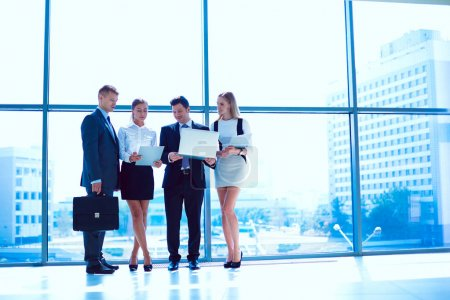 Photo for Group of business people doing presentation with laptop during meeting. Group of business people. - Royalty Free Image