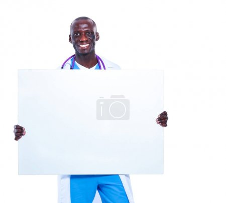 Male doctor holding empty placard, isolated on white background