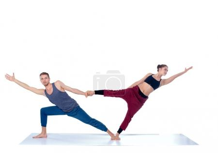 Photo for Young athletic couple practicing acroyoga. Balancing in pair. - Royalty Free Image
