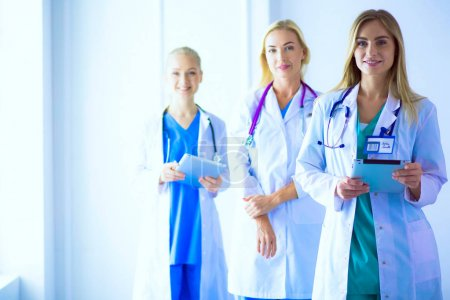 Photo for Portrait of three confident female doctors standing with arms crossed at the medical office - Royalty Free Image