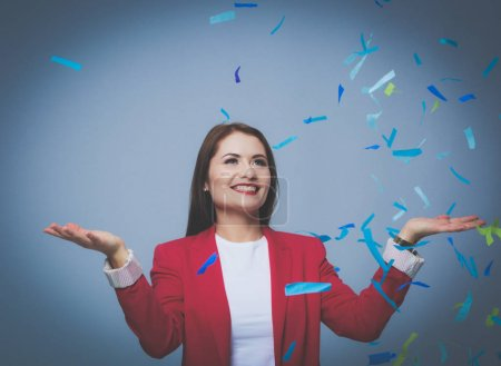 Photo for Beautiful happy woman at celebration party with confetti .Birthday or New Year eve celebrating concept - Royalty Free Image