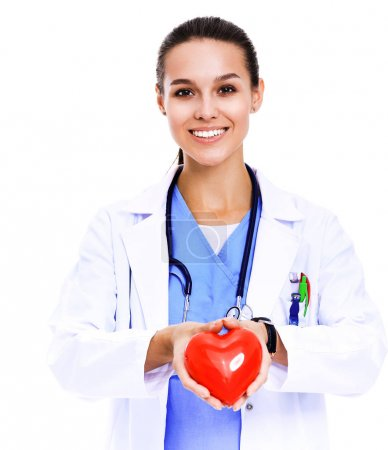 Photo for Positive female doctor standing with stethoscope and red heart symbol isolated. Woman doctor. - Royalty Free Image