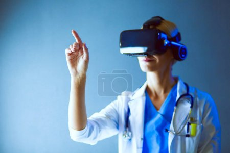 Photo for Female doctor wearing virtual reality glasses isolated on white background - Royalty Free Image