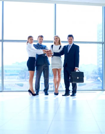 Photo for Business people with their hands together in a circle . Business people - Royalty Free Image