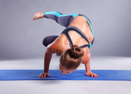 Photo for Portrait of sport girl doing yoga stretching exercise. yoga. - Royalty Free Image