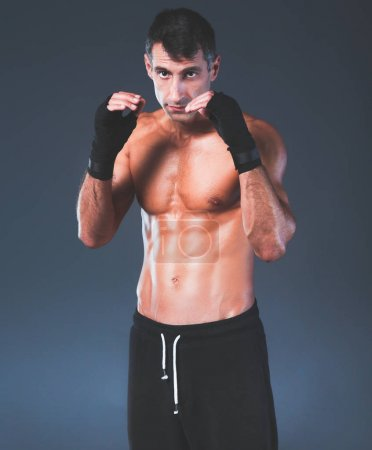 Profile view of young man practicing boxing