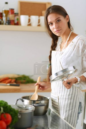 Photo for Cooking woman in kitchen with wooden spoon. Cooking woman. - Royalty Free Image