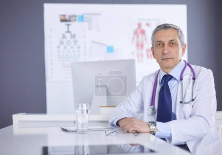Photo for Portrait of a smiling doctor in his bright office. - Royalty Free Image