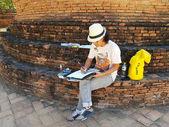AYUTTHAYA, THAILAND - NOVEMBER 29: Unidentified Japanese tourists painting at Wat Phra Sri Sanphet  in the Ayutthaya Historical Park on November 29, 2016 in Ayutthaya, Thailand