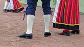 Legs of  man and woman in Estonian traditional suits