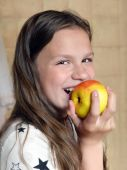 Girl laughs and eats  apple