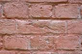 Fragment of a pink brick wall.