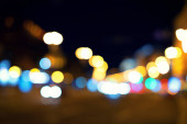 Blurred image of a night city street. Bokeh background.