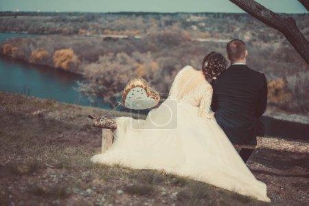 Runaway Bride. Wedding. Groom catches his bride. l...