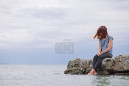 Photo for Woman alone and depressed on the bridge - Royalty Free Image