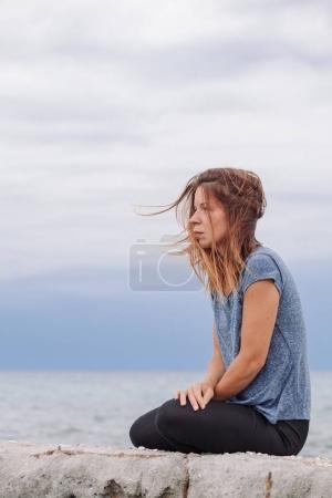 Photo for Woman alone and depressed at seaside - Royalty Free Image