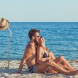 Young couple in love on the beach, enjoying...