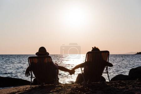 Couple enjoying sunset at a beach