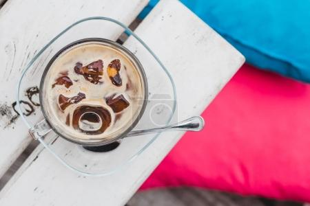 Close-up of the cup of ice coffee on the table