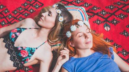 Two hippie girlfriends enjoying in the countryside