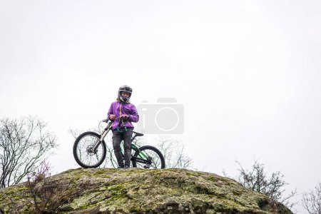 Cyclist descends from the mountain on a mountain bike, free space for your text.