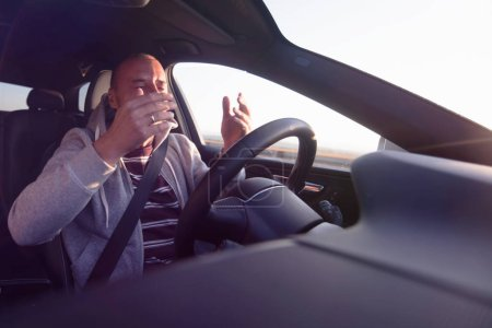 Photo for Young man driving a car shocked about to have traffic accident. - Royalty Free Image