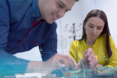 Photo for Two young handsome engineers working on electronics components.Tech tests electronic equipment in service center. Technologically Advanced Scientific Research Center. - Royalty Free Image