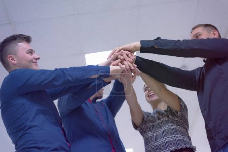 Photo for Young business people, Teamwork Stacking Hand Concept. Close up of young people putting their hands together. Business people with stack of hands showing unity and teamwork. - Royalty Free Image