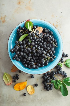 Aronia with leaves in bowl