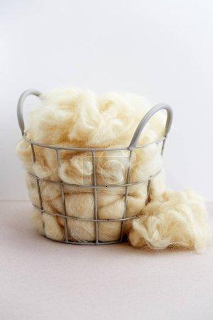 Basket of raw natural fiber