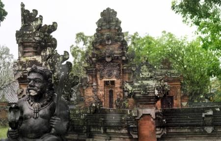 Photo for Balinese temple and a sculpture god under rain at Ubud. - Royalty Free Image