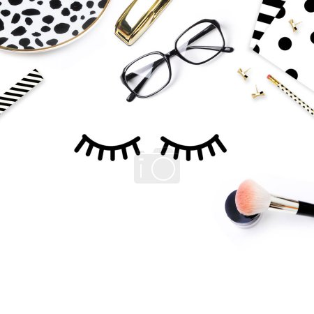 Feminine desk. Woman workspace. Pretty background. Eyelashes with accessory. Black and white pattern. Flat lay. View top.