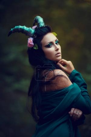 brunette girl with horns