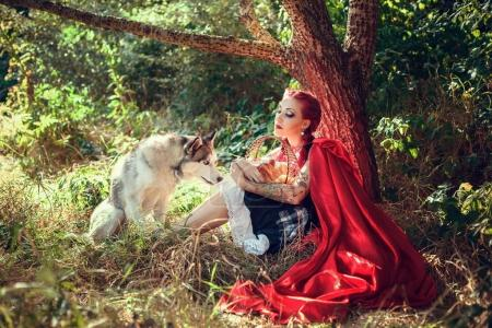 Woman with husky dog