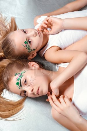 girls with green paint on faces