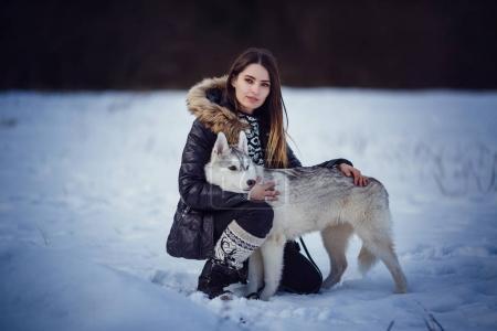 female hiker with siberian husky dog
